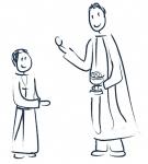 Chłopiec przyjmuje komunię